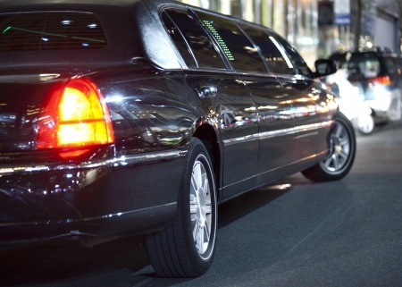 15984039 - low angle view of black limousine in city at night