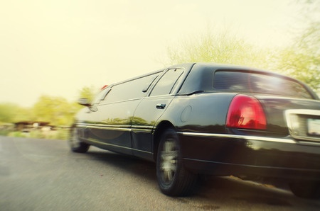 27216679 - limo stretch limousine car moving away