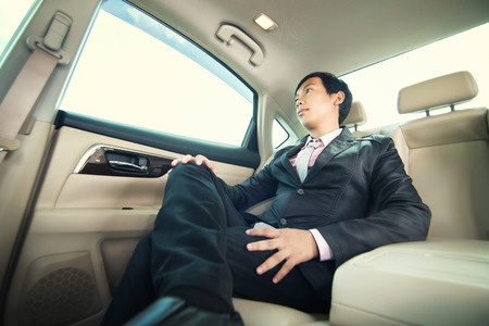 40866460 - businessman sitting in luxury car.
