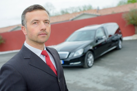 48203641 - funeral director with car