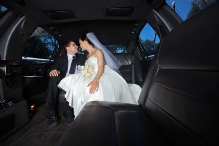 10723114 - loving newlywed bride and bridegroom in car
