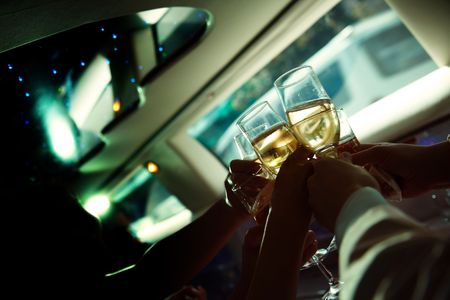 10728968 - the human hand holding wine glasses in limousine