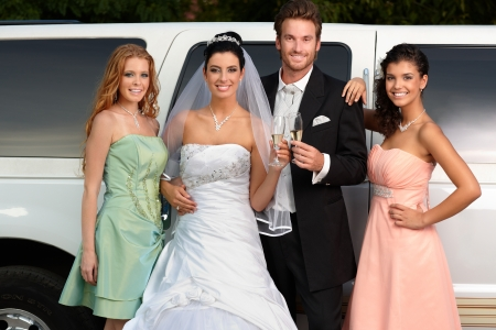 14767420 - young couple with bridesmaids on wedding-day.